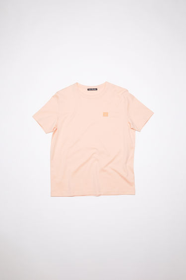 Acne Studios powder pink organic cotton t-shirt features a ribbed crew neck and an embroidered tonal face patch.