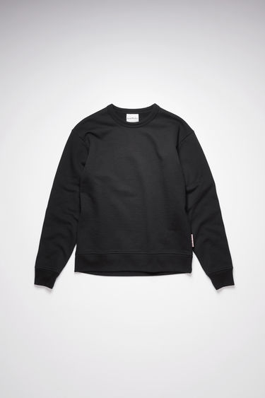 Acne Studios black sweatshirt is crafted from organically grown cotton and recycled polyester that's enzyme-washed for a soft handle and neatly finished with ribbed trims around the neckline, cuffs and hem.