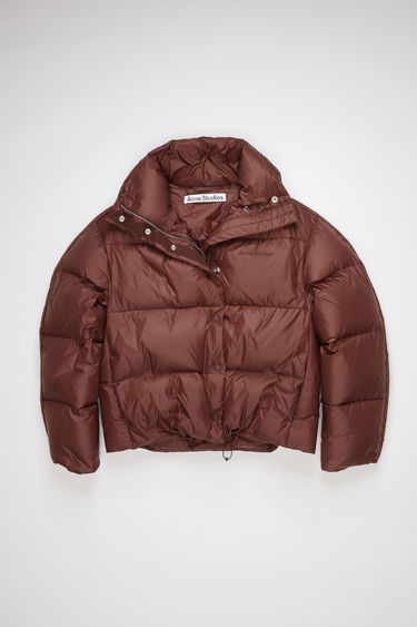 Acne Studios maroon red quilted down jacket is made of nylon with Acne Studios branding at the chest.