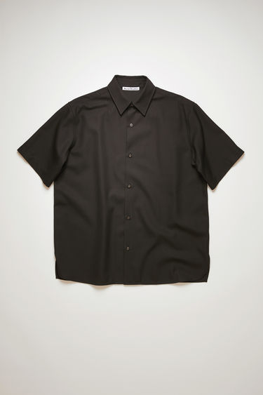 Acne Studios black short-sleeved shirt is cut to a boxy silhouette with a straight hem and has a pointed collar and tonal buttons through the placket.