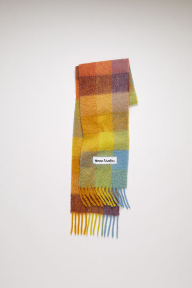 Acne Studios yellow/powder blue/brown checked scarf is spun from alpaca, wool and mohair yarns to a wide dimension and features a stitched logo patch above the fringed edges.