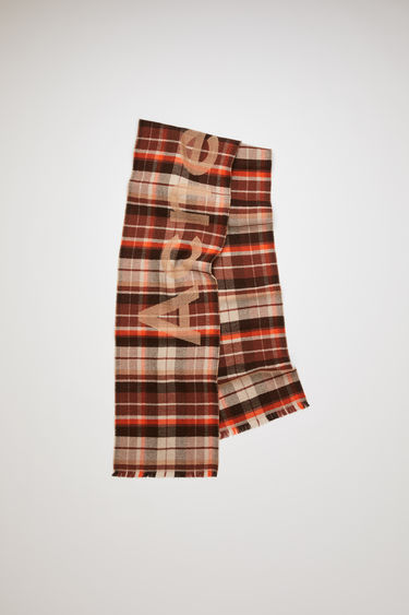 Victoria brown/orange skinny check scarf is crafted from soft compact wool and detailed with Acne Studios logo.
