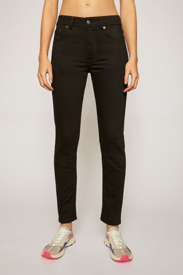 Acne Studios Melk Stay Black jeans are crafted from comfort stretch denim and shaped to sit high on the waist with slim, tapered legs.