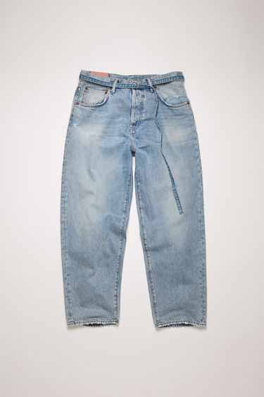 Acne Studios 1991 Toj Light Blue Trash jeans are crafted from rigid denim with wide, straight legs that's been washed to give a whiskered, lived-in appeal. They can be worn on the natural waistline or pulled to a high rise with a matching belt.  The female model is wearing two sizes larger than her actual size to achieve a looser fit.