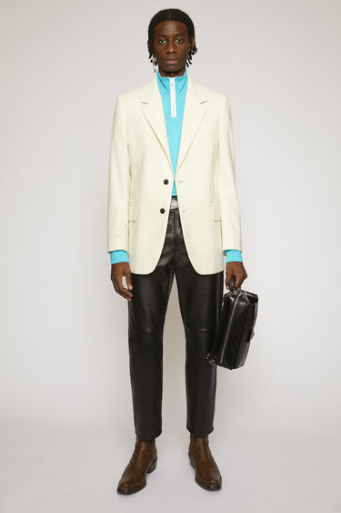 Acne Studios white suit jacket is crafted from a virgin wool twill with notch lapels and has full lining and structured shoulders.