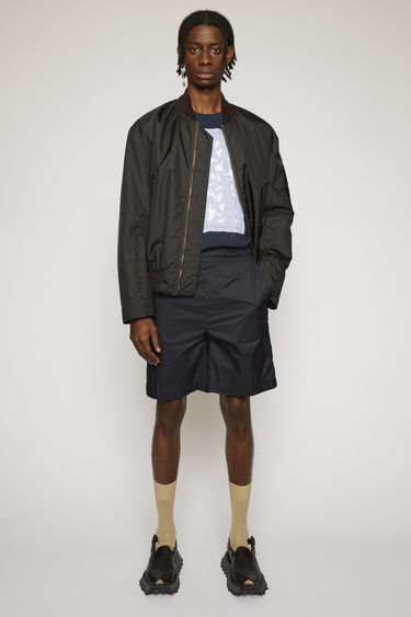 Acne Studios navy shorts are cut from lightweight ripstop with a high-rise waist and straight legs and finished with an elasticated waistband.