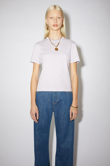 Acne Studios lavender purple short sleeve t-shirt features a ribbed crew neck and an Acne Studios logo tab.