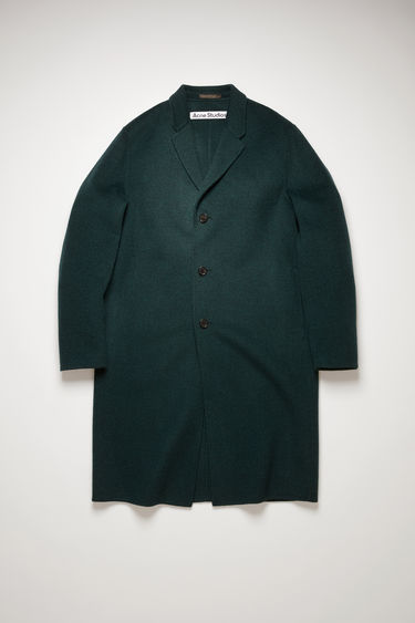 Acne Studios Chad forest green coat is crafted from double-faced wool to an oversized silhouette with notched lapels and side slip pockets, then finished with three button closures.