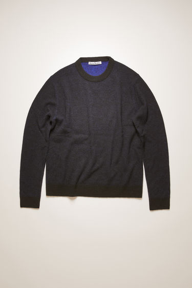 Acne Studios black/purple sweater is knitted from soft cashmere and is cut to a relaxed shape, with a crew neck, and is trimmed with ribbed edges.