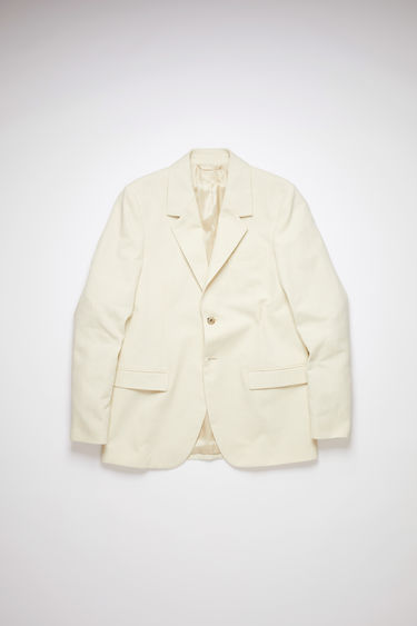 Acne Studios ecru beige constructed suit jacket is made of a cotton/linen blend with a classic fit.
