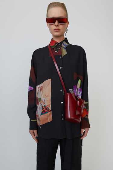Acne Studios black shirt is cut to a relaxed fit and shaped with a neat point collar. Each shirt is uniquely patterned with a collage of flower prints.