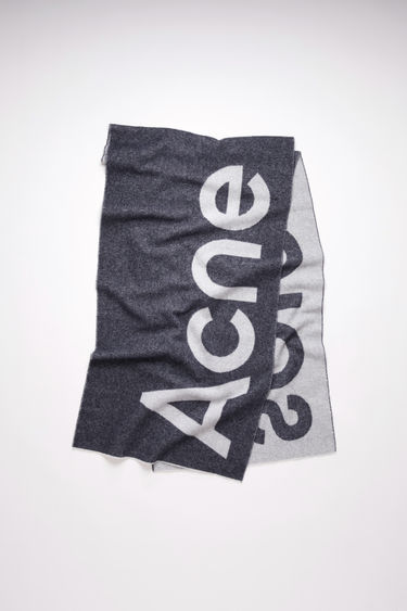 Acne Studios Toronty Logo black scarf is crafted to a generous dimension from a soft wool blend and features a bold logo lettering on both sides.