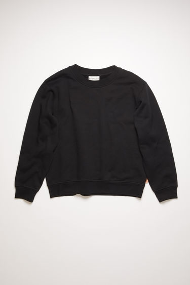 Acne Studios black sweatshirt is cut from brushed cotton jersey with ribbed trims and has a pink logo-jacquard tab sewn on the side seam.