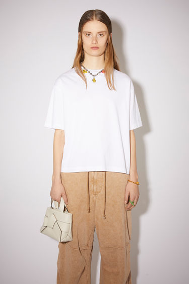Acne Studios optic white short sleeve t-shirt features a ribbed crew neck and an Acne Studios logo tab.