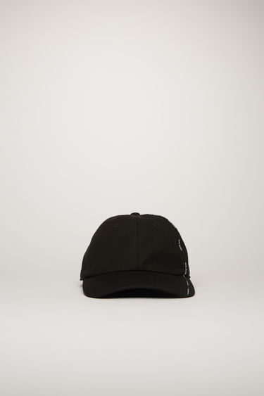 Acne Studios black cap is crafted from cotton-canvas to a classic six-panel shape with a curved brim and features an elasticated back closure and a logo piping along the side.