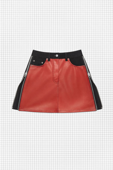 Acne Studios Repurposed black/red panel skirt is made of rigid black denim and red leather, featuring zipper details and a leather waistband. It has a short, straight fit.