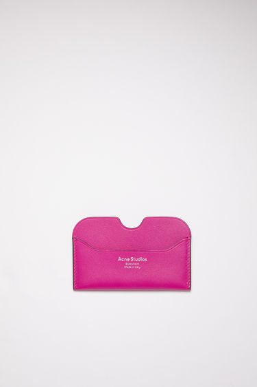 Acne Studios fuchsia pink card holder is made of soft grained leather with a silver logo stamp.