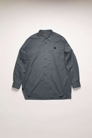 Acne Studios navy blue checked shirt is crafted from organic cotton to a boxy shape with an oversized fit and finished with a button-down front closure and face-embroidered patch on the chest.