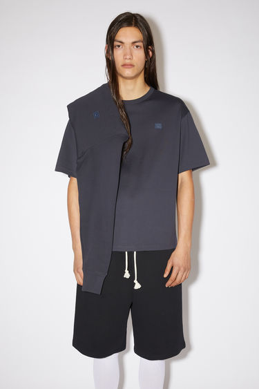 Acne Studios navy organic cotton t-shirt features an embroidered face patch on the chest.