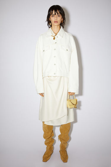 Acne Studios white cropped jacket is made of rigid cotton denim with an oversized fit.