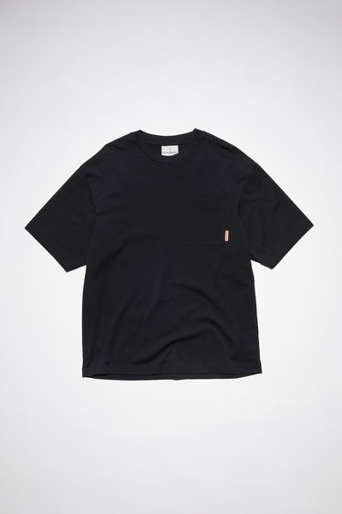 Acne Studios black crew neck t-shirt is made of cotton, featuring a single chest pocket with an Acne Studios logo tab.