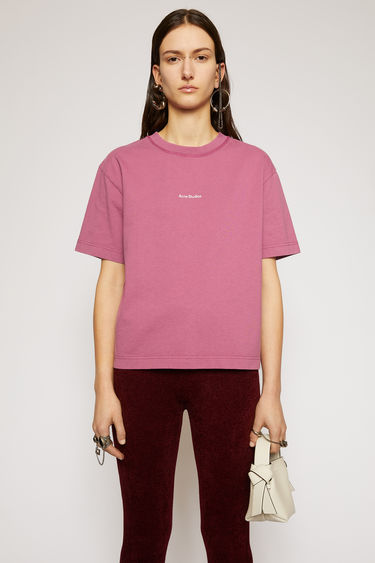 Acne Studios violet pink t-shirt is made from pigment-dyed jersey that's lightly faded along the seams. It's cut to a relaxed silhouette with dropped shoulders and features a raised logo print on front.