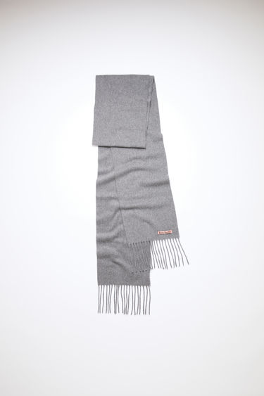 Acne Studios grey melange skinny fringed scarf is made of pure wool, featuring a label across one corner.