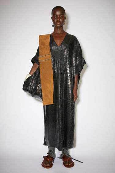 Acne Studios black unlined metallic kaftan is made of leather.