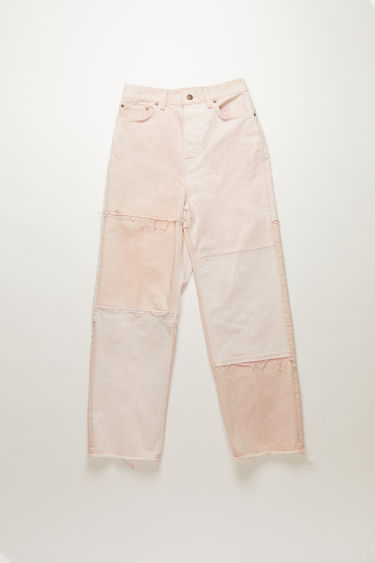 Acne Studios 1993 RF Pink jeans are handcrafted in a patchwork pattern from deadstock denim and finished with raw edges along the seams. They're cut to a super high-rise silhouette and shaped to loose, tapered legs.