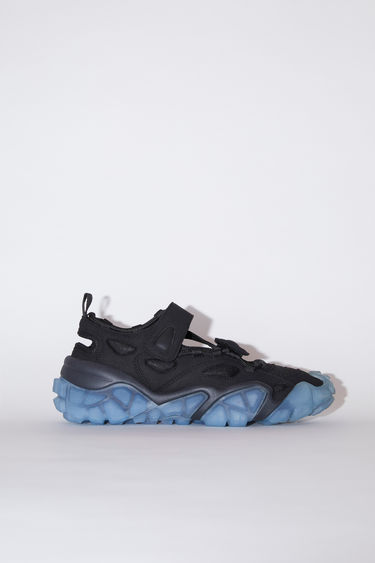Acne Studios black/blue velcro strap sneakers have contrasting, translucent soles.