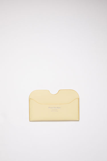Acne Studios vanilla yellow card holder is made of soft grained leather with a silver logo stamp.