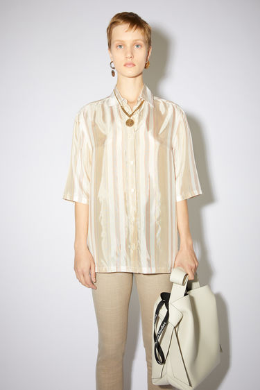 Acne Studios red/brown striped blouse has a relaxed fit with button closures.