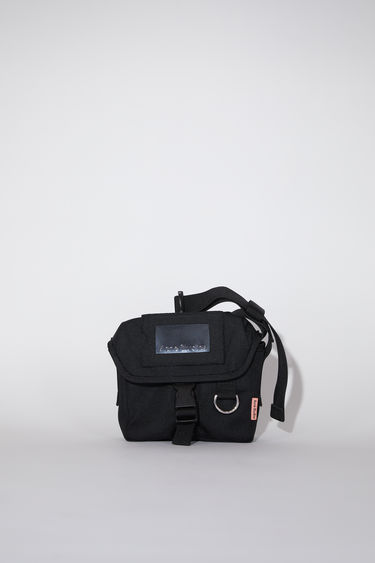 Acne Studios black durable small messenger bag has an adjustable hard plastic buckle closure and Acne Studios logo tab.