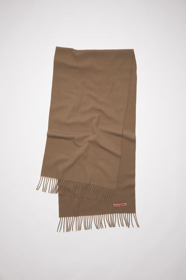 Acne Studios caramel brown oversized fringed scarf is made of pure wool, featuring a label in one corner.