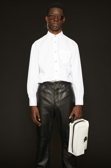 Acne Studios optic white shirt is crafted from lightweight cotton poplin with a chest pocket and finished with a chest pocket and a button-down collar.