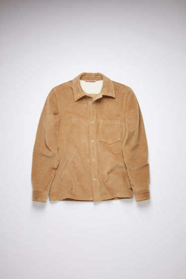 Acne Studios camel brown long sleeve corduroy shirt is made of a cotton blend with a boxy, cropped fit.