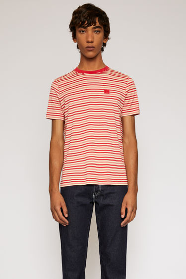 Acne Studios poppy red t-shirt is patterned with breton stripes and finished with a face-embroidered patch on the chest.