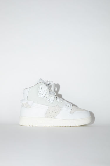 Acne Studios multi white high top sneakers are made of leather with face details and Acne Studios branding on the rubber soles.