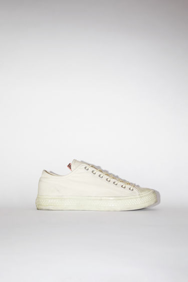 Acne Studios off white/off white distressed canvas lace-up sneakers have rubber toes and soles.