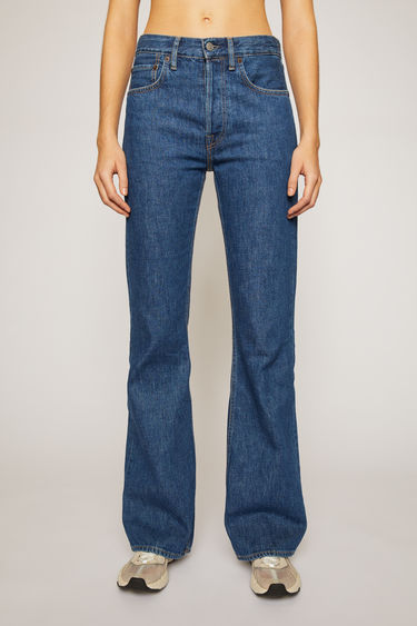 Acne Studios 1992F Dark Blue Trash jeans are crafted from rigid denim that's washed to give a time-worn appeal. They're cut to a relaxed, bootcut silhouette with a high-rise waist and finished with a concealed button placket.