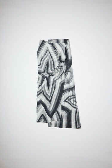 Acne Studios black/white skirt is made of star print linen with beaded embellishments. In collaboration with Ben Quinn.