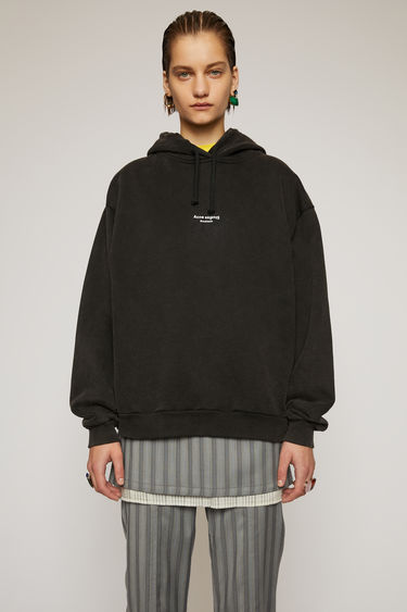 Acne Studios black hooded sweatshirt is made from cotton jersey that has been garment dyed for a soft, washed-out finish. It's cut to an oversized fit and features a reversed logo printed across the chest.