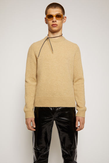 Acne Studios beige melange sweater is knitted from soft wool yarn with a classic crew neck and framed with thick, ribbed edges.