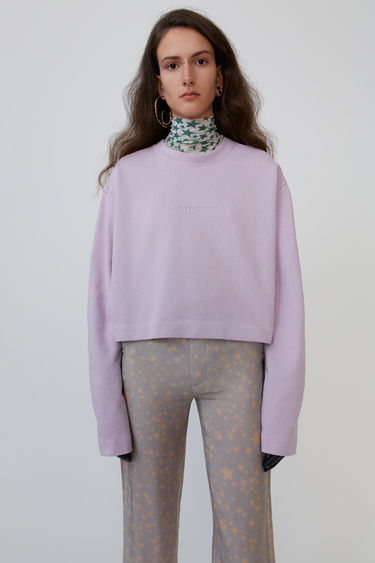 Acne Studios Odice Emboss lavender purple is a cropped sweatshirt with an embossed logo on the chest.