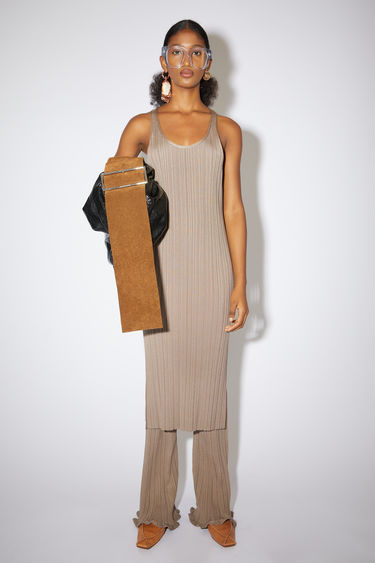 Acne Studios taupe beige scoop neck dress is made of an irregular rib knit with a straight fit.