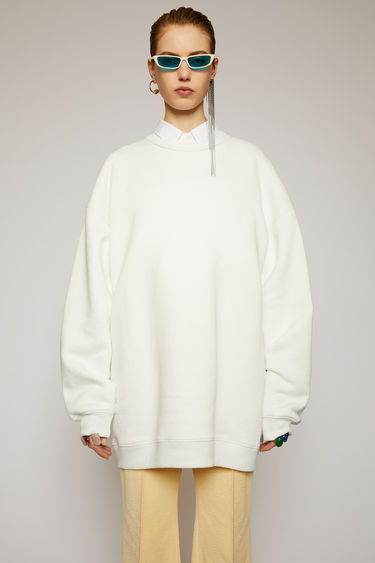 Acne Studios optic white sweatshirt is crafted for an oversized fit from midweight loopback jersey and adorned with a label patch that's left with loose thread for a subtle note of texture.