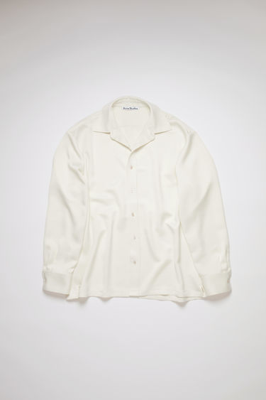 Acne Studios champagne beige casual, long sleeve shirt features a boxy fit with side vents.