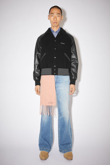Acne Studios black bomber jacket is made of a wool blend with leather raglan sleeves and a cropped fit.