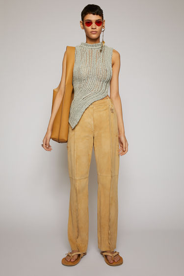 Acne Studios almond beige suede trousers are cut to sit on the mid waist and shaped with straight, loose-fit legs. They feature inverted seams at the front and silicone-dipped knots.