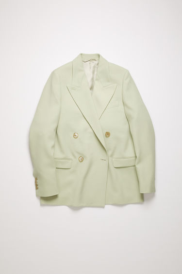 Acne Studios pastel green wool-blend suit jacket is crafted to a double-breasted silhouette and finished with wide notch lapels and two front flap pockets.